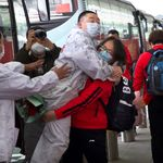 Masked Crowds Fill Streets, Trains After Wuhan Lockdown