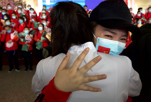 A medical worker from China's Jilin Province reacts as she prepares to return home at Wuhan Tianhe International