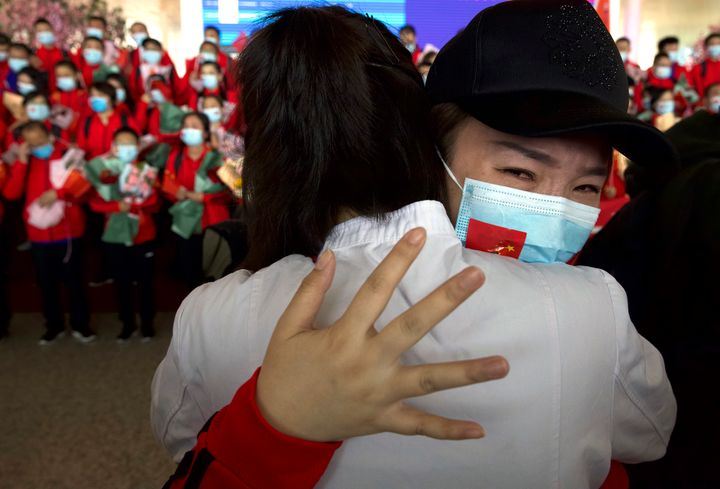 A medical worker from China's Jilin Province reacts as she prepares to return home at Wuhan Tianhe International Airport.