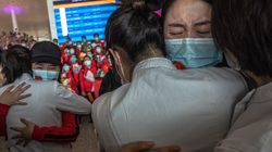 Masked Crowds Fill Wuhan's Streets As Coronavirus Lockdown