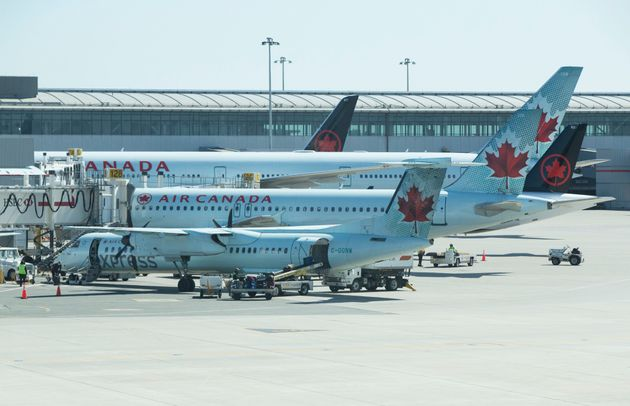 Air Canada airplanes are seen at Pearson International Airport in Toronto, March 21, 2020. Air Canada...