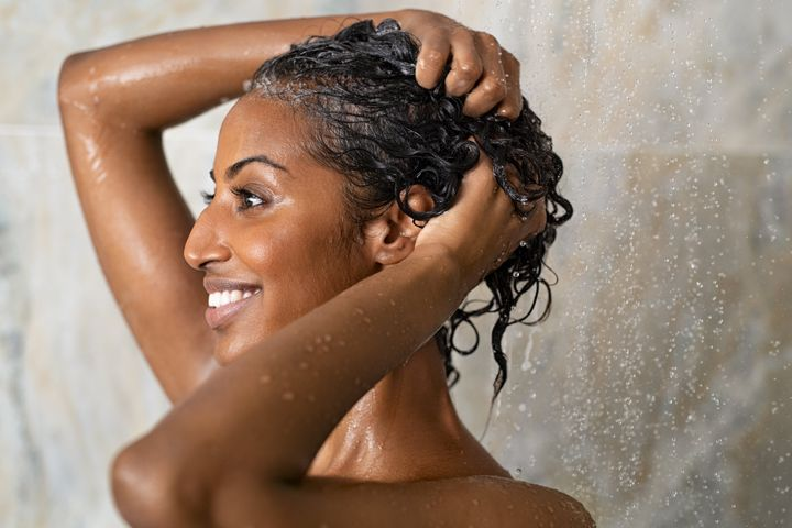 Now is the time to heed your stylist's advice about shampooing less.