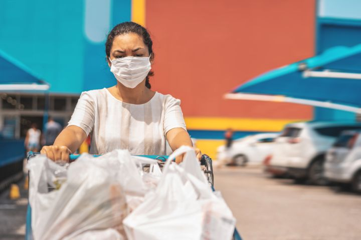 Grocery delivery workers are braving the market for those who can't or don't want to leave their homes during the pandemic.