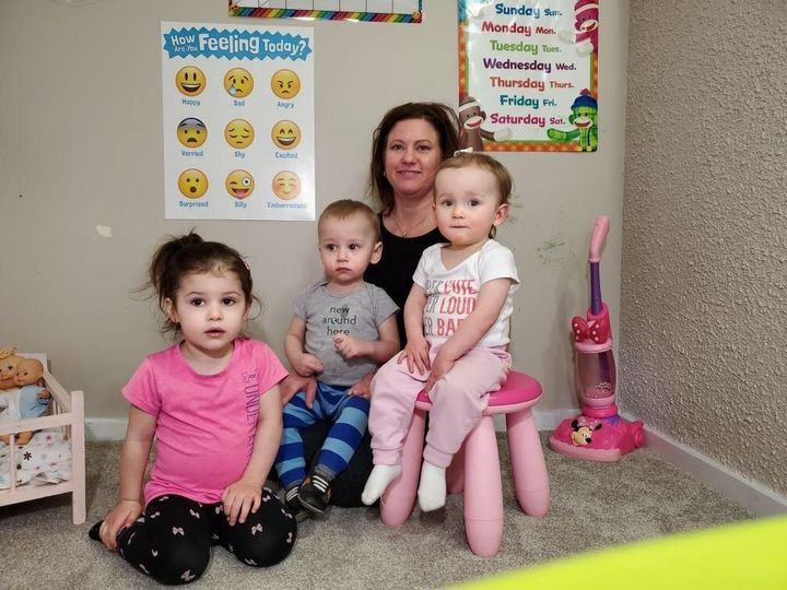 Edmonton day home provider Kim Troy is shown in a photo with some children she cares for. (The parents of the children consented to this photo being shared with HuffPost Canada).