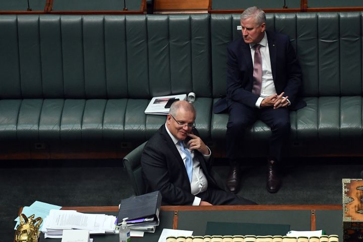 Prime Minister Scott Morrison reacts during a division for amendment to the Coronavirus Economic Response Bill in the House of Representatives at Parliament House on April 08, 2020 in Canberra, Australia.