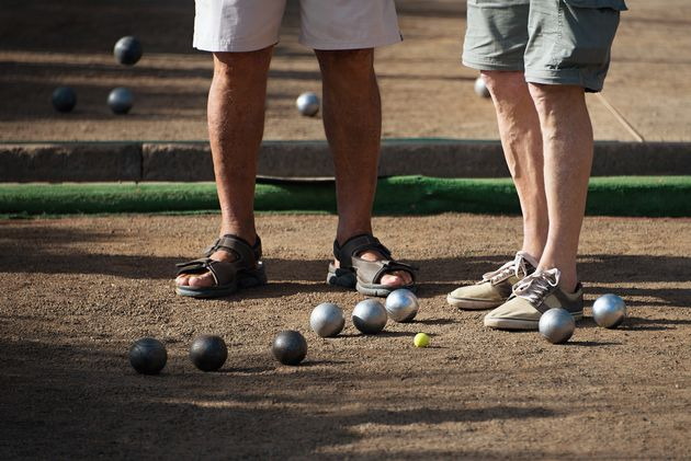 Old mens playing petanque in a city park,relaxation
