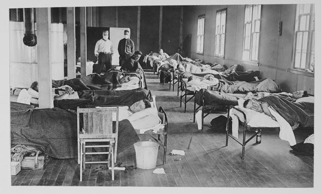 View of victims of the Spanish flu cases as they lie in beads at a barracks hospital on the campus of...