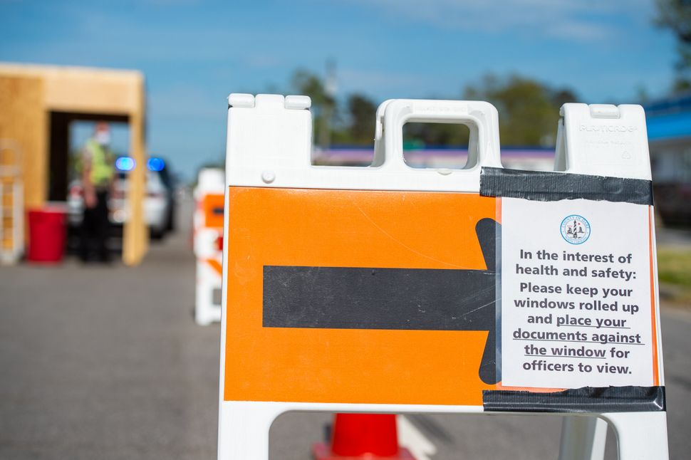 Posted signs alert drivers to safety procedures at this roadblock checkpoint just west of the Virginia Dare Memorial Bridge.