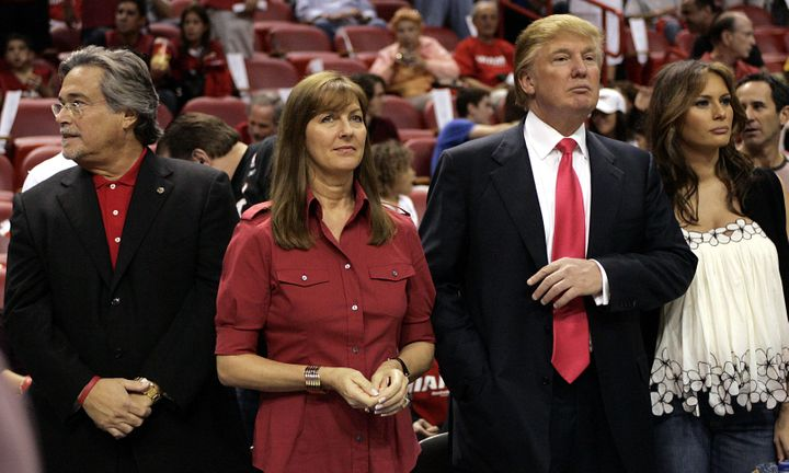 Micky and Madeleine Arison with Donald and Melania Trump at a Miami Heat basketball game in December 2005. Arison is both the