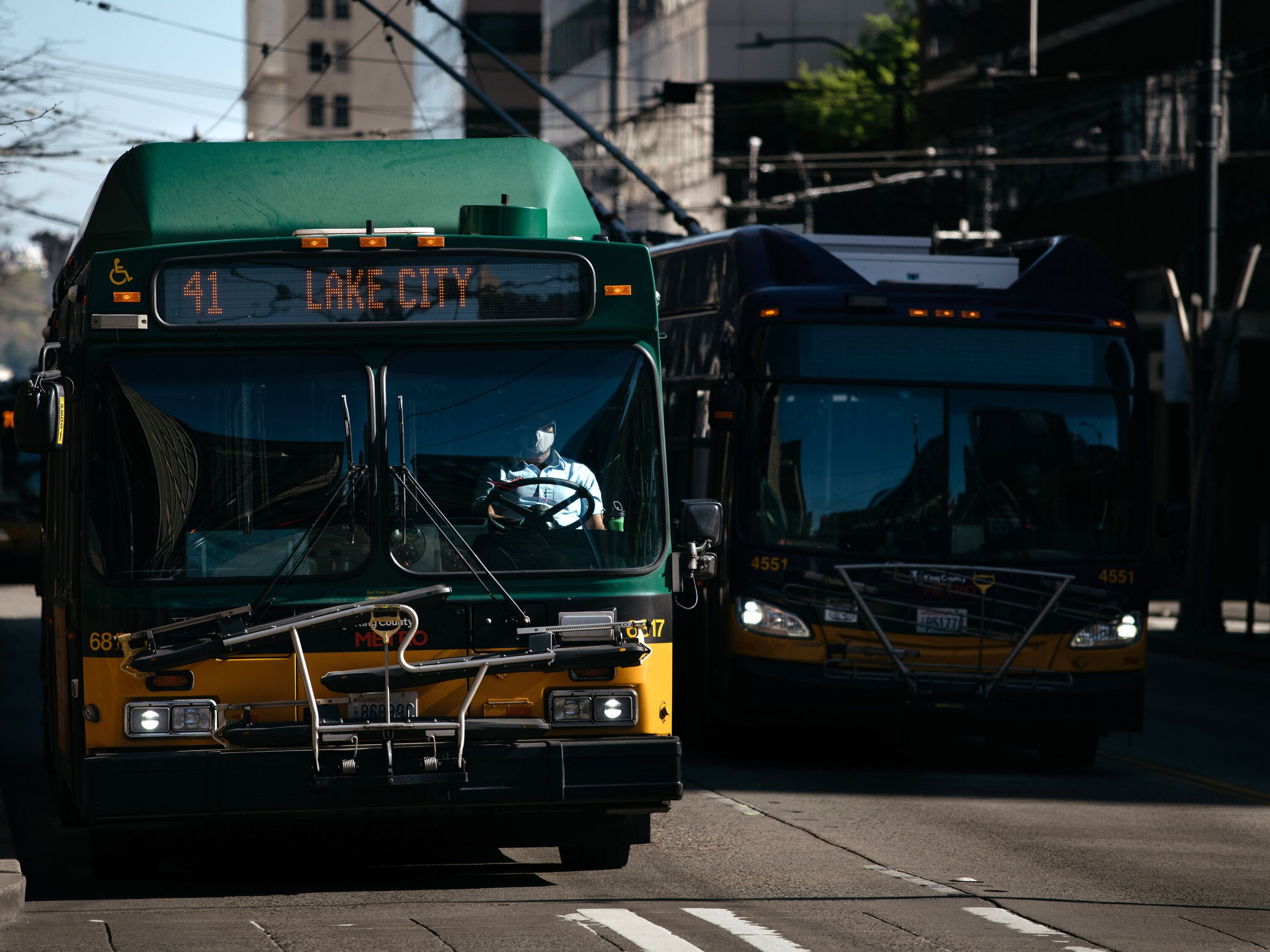 A King County Metro bus driver pilots a bus down a quiet 3rd Avenue, the city's main bus corridor, when rush hour would