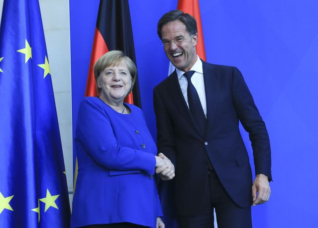 BERLIN, GERMANY - OCTOBER 02 : German Chancellor Angela Merkel (L) and Dutch Prime Minister Mark Rutte...