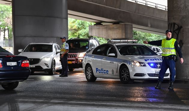 Police control car park entries to ensure safe social distancing at Sydney Fish Market on April 10, 2020...