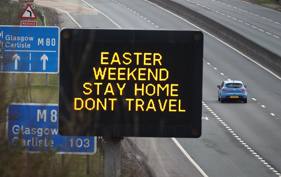 A road sign advising drivers to stay home and not to travel during the Easter Weekend on the M80 near Banknock as the UK continues in lockdown to help curb the spread of the coronavirus.