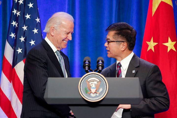 Joe Biden (left) with Gary Locke (right) in Beijing in 2013.