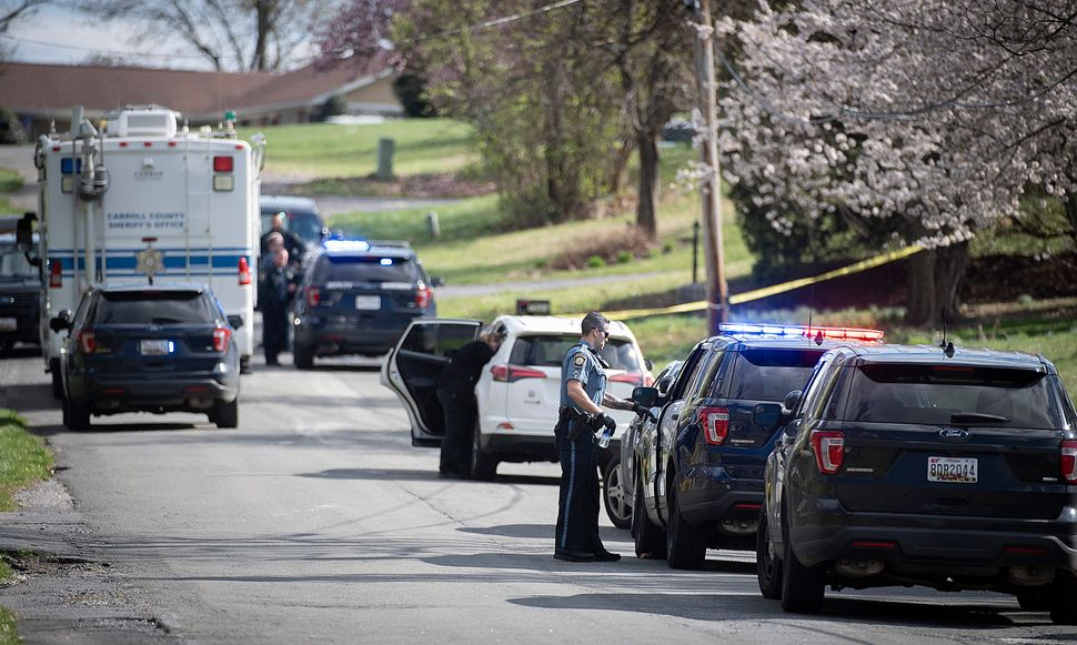 Police respond to a shooting in Maryland on April 2. It was one of three domestic violence murder-suicides that day.