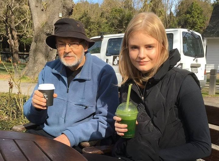 The author and her father at a farmers market in 2018.