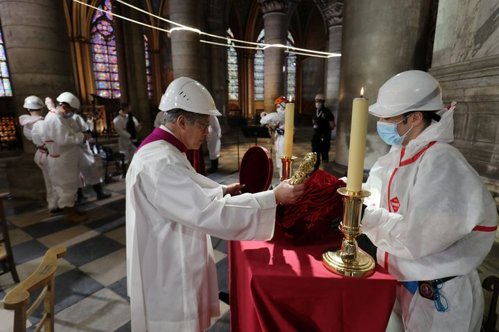 Notre Dame rector Patrick Chauvet repositions the holy crown of thorns, a relic of the passion of Christ, after a ceremony ma