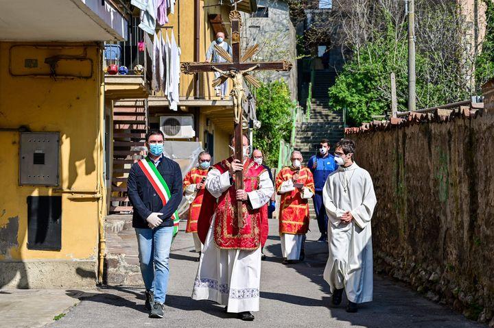 Rev. Giovanni Cominardi (center), priest of Santa Maria Assunta church in Pontoglio, Italy, and Pontoglio's mayor, Alessandro