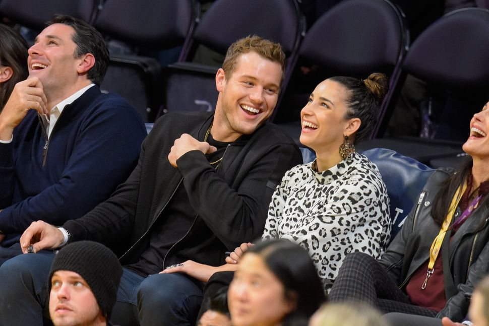 Colton Underwood (L) and Aly Raisman attend a basketball game between the Portland Trail Blazers and the Los Angeles Lakers a