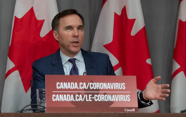 Minister of Finance Bill Morneau responds to a question during a news conference in Ottawa on March 27,