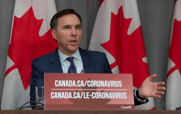 Minister of Finance Bill Morneau responds to a question during a news conference in Ottawa on March 27, 2020.
