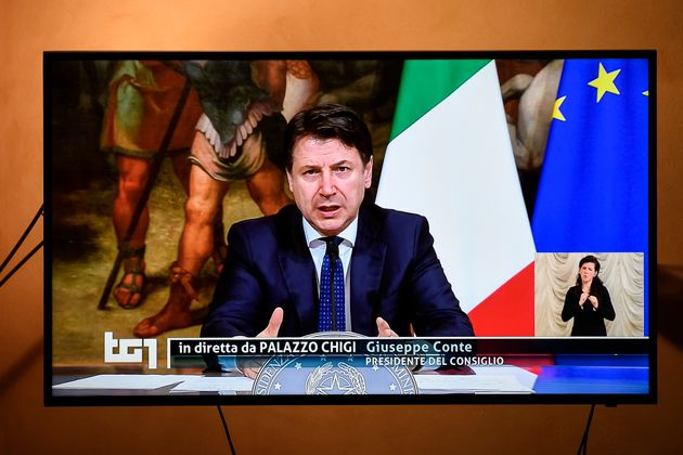 TURIN, ITALY - 2020/04/01: An image on television of Italian Prime Minister Giuseppe Conte, broadcast...