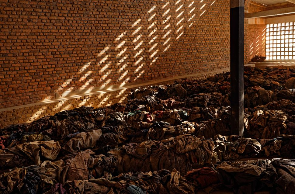 Piles of clothes belonging to victims who sought refuge inside a church, as a memorial to the hundreds of thousands who were