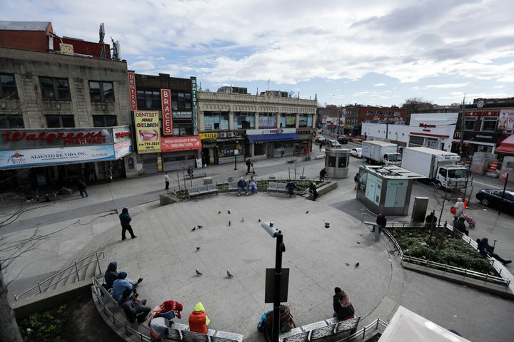 Pedestrians walk Corona Plaza in Queens, NYC on April 2, 2020. Data released by city health officials show that residents in