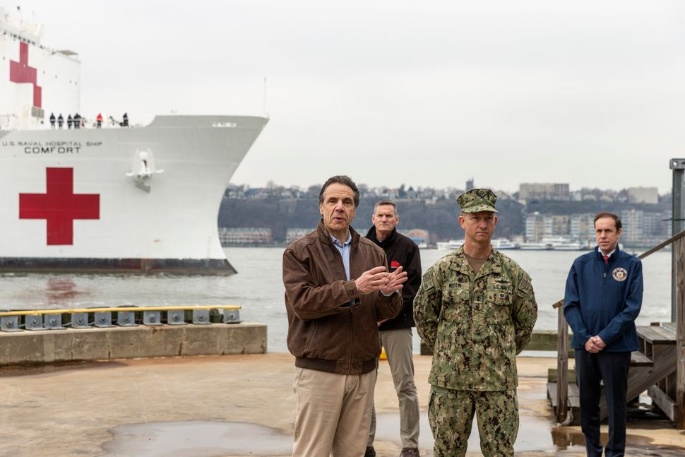 New York Gov. Andrew Cuomo speaks as the Navy hospital ship Comfort arrives in Manhattan to help relieve the strain on area h