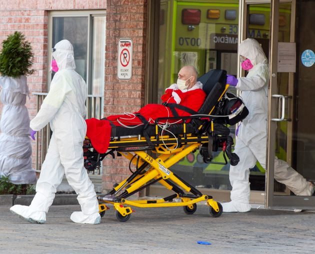 First responders transport a resident of a seniors home to hospital, on March 31, 2020 in
