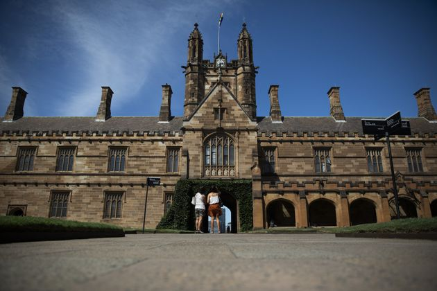 People stand at the quadrangle of the University of Sydney in Sydney, Australia, on Tuesday, Feb. 25,