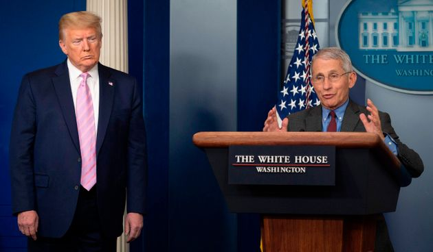 US President Donald Trump (L) listens as Director of the National Institute of Allergy and Infectious...