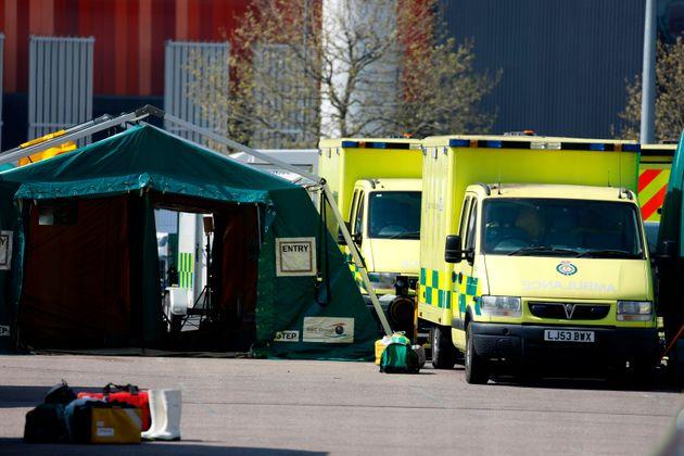 Ambulances are seen parked up outside the Nightingale coronavirus hospital in