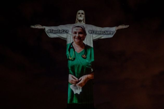 View of a medical worker on the illuminated statue of Christ the