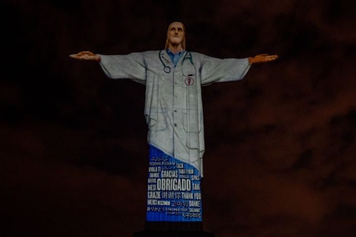 "View of the illuminated statue of Christ the Redeemer that reads ""Thank you"" in many languages on April 12."