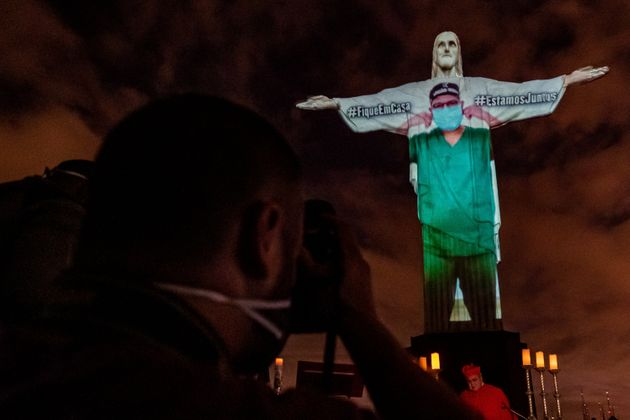 Rio De Janeiro's Christ The Redeemer Lit Up To Look Like Doctors On Front