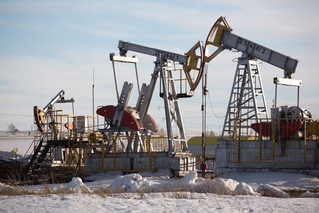 Oil pumping jacks operate in an oilfield near Almetyevsk, Russia, on March