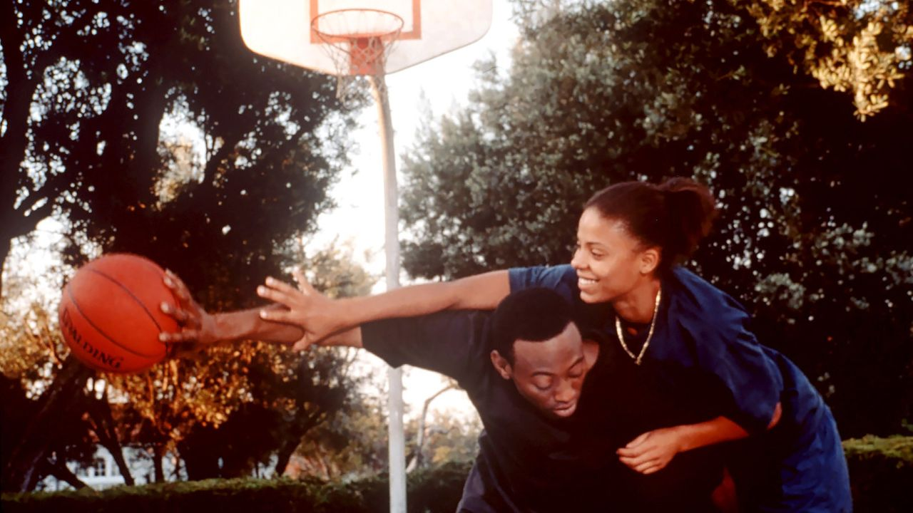 "Omar Epps and Sanaa Lathan in ""Love & Basketball."""