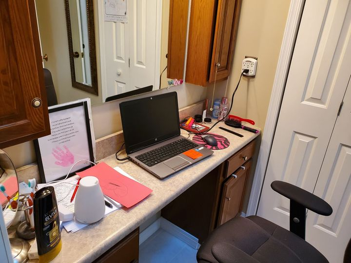 Food bank worker Angela Small transformed her master bathroom into a home office.