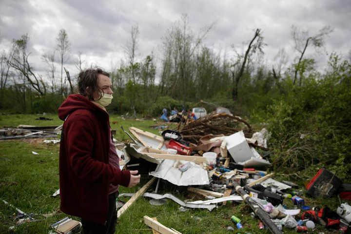 Michael Berhm, 16, stands next to his destroyed mobile home after a tornado hit, Monday, April 13, 2020, in Chatsworth, Ga. (