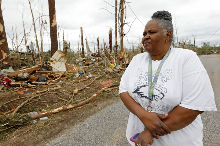 Sarah Cook looks at the remnants of houses and mobile homes in this Bassfield, Miss., neighborhood, Monday, April 13, 2020. T