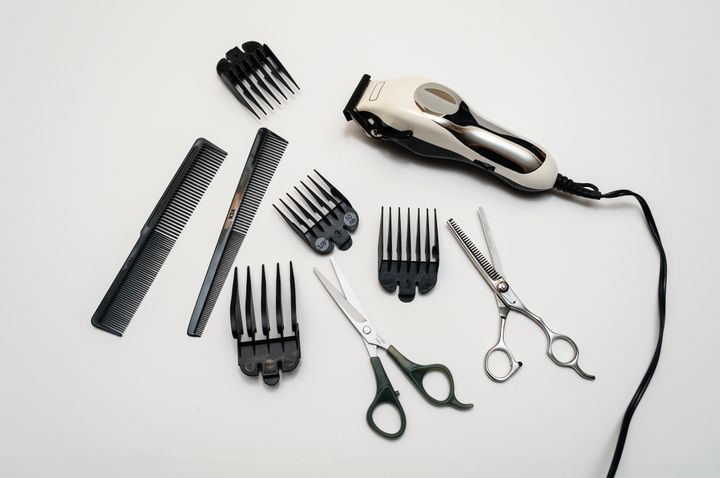 Hair clippers, scissors and assorted guards.