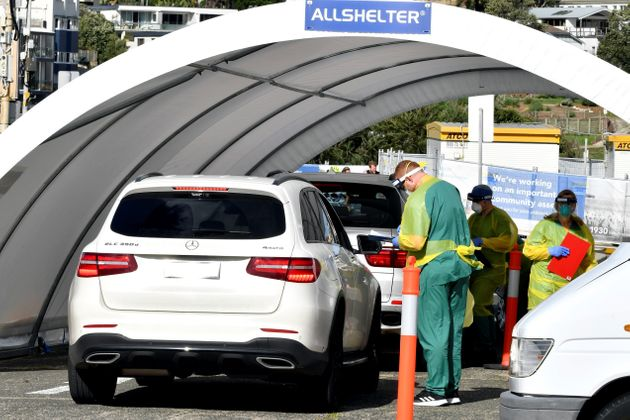Medic perform COVID-19 tests on a member of the public at a drive-through COVID-19 testing center on...