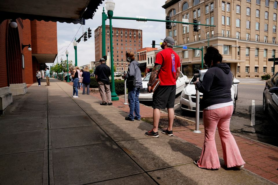 People who lost their jobs wait in line to file for unemployment following the coronavirus outbreak,...