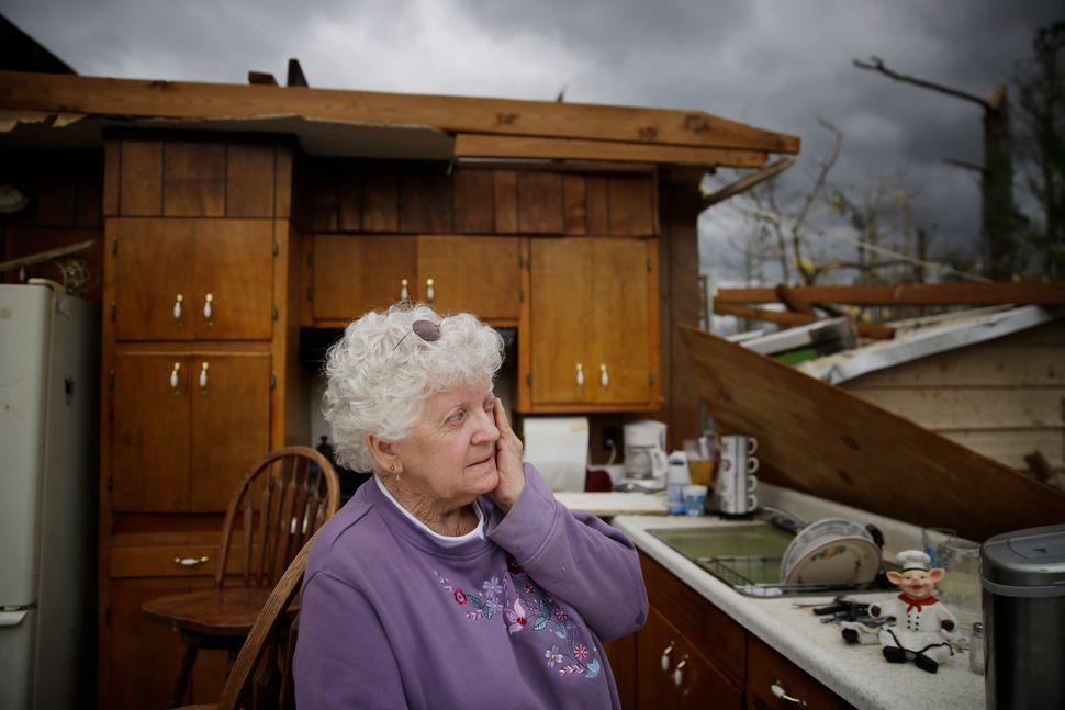 Emma Pritchett in her roofless kitchen on April 13, 2020, the day after a tornado hit, in Chatsworth, Georgia.