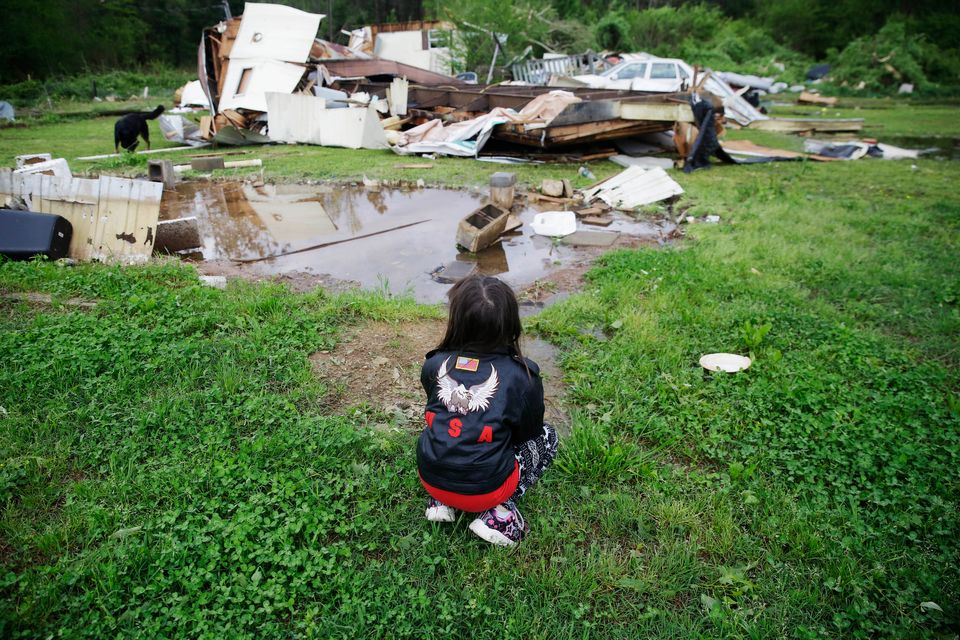 Sky Kriner, 5, looks on after a tornado hit in Chatsworth,