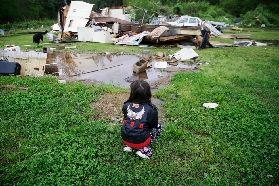 Sky Kriner, 5, looks on after a tornado hit in Chatsworth, Georgia.