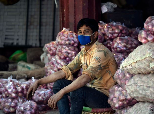 A man selling onions at Okhla Mandi on April 13, 2020 in New