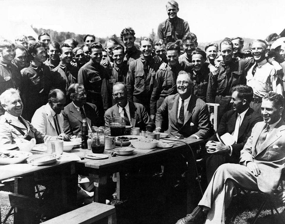 President Franklin Roosevelt visits Civilian Conservation Corps Camp #350 in Virginia's Shenandoah Valley with his aide Rexfo
