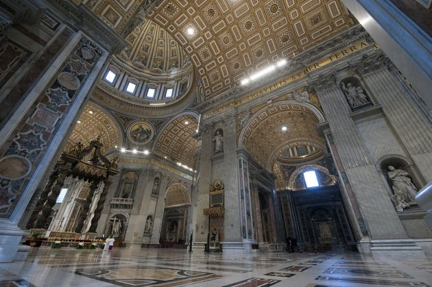 Pope Francis gives a blessing on Easter Sunday inside an empty Vatican